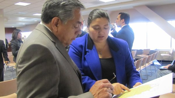 Latino community leaders Artie Blanco and Fernando Romero examine a map of Las Vegas' Latino neighborhood at the April 2 legislative redistricting hearing.