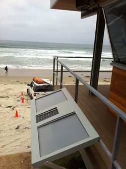 Solar cells on new lifeguard tower heat water and power pump