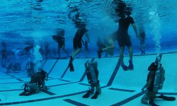 Students from Basic Underwater Demolition/SEAL (BUD/s) Class 287 participate in night gear exchange during the second phase of training at Naval Amphibious Base Coronado.
