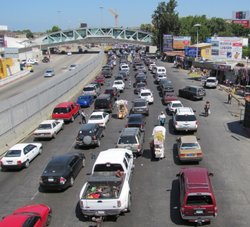 Cars wait to enter the U.S. from Mexico at the San Ysidro Port of Entry near San Diego on August 1.