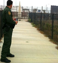 A U.S. Border Patrol agent keeps watch at Friendship Park at the U.S.-Mexico border near San Diego.