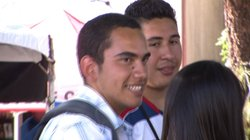 Christian Castro talks with friends outside the San Diego State Bookstore, August 29, 2011.