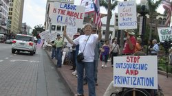 Protestors lined Broadway in downtown San Diego on Labor Day, demanding a jobs creation program from the government.