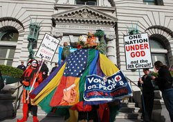 An opponent of Prop 8 wears a gay pride flag as he dances in front of Prop 8 supporters outside of the Ninth Circuit Court of Appeals on December 6, 2010 in San Francisco, California.