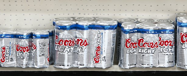 "Artist Jean Lowe's deceivingly lifelike ""Six Packs"" added a whimsical element to ""Discount Barn."" (Enamel on cardboard, wood, 2011)."