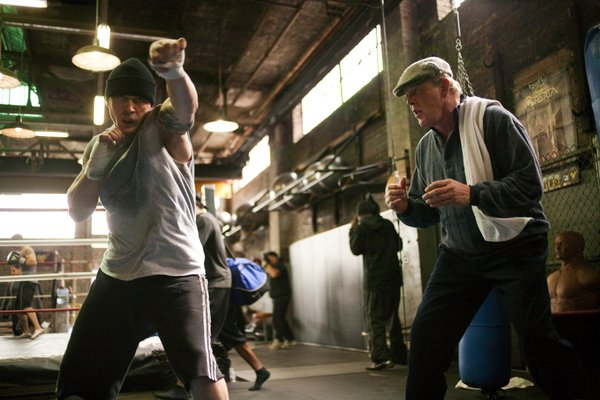 "Tommy (Tom Hardy) reluctantly working out with his estranged father (Nick Nolte) in ""Warrior."""