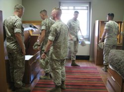 Marines explore one of the new bedrooms in the $130 million barracks. Each room has 2 beds, a fridge, a microwave, a private bath and a walk in closet.