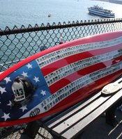 9/11 memorial surfboard featuring New York City fire fighters