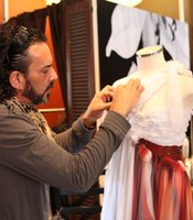 Jeffrey Parish puts finishing touches on his Art of Fashion design in his South Park boutique.