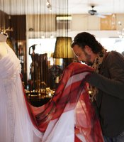 Jeffrey Parish checks the drapery of his design at Junc Boutique in South Park.