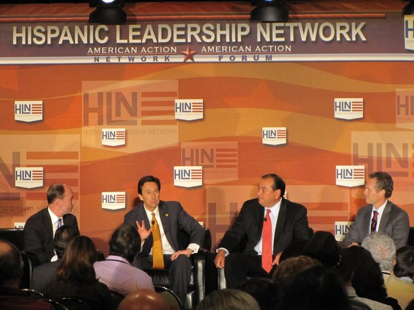 Panelists speak at the Hispanic Leadership Network conference in Albuquerque. From Left to Right: Doug Holtz-Eakin, president of American Action Forum; Jon Barela, New Mexico secretary of economic development; Massey Villarreal, CEO of Precision Task Group, Inc.; and Ruben Barrales, president and CEO of the San Diego Regional Chamber of Commerce.