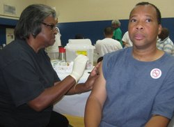 A Skyline resident gets a flu shot at a community clinic sponsored by HHSA and the San Diego Black Nurses Association. 