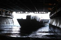 A landing craft unit from the Naval Amphibious Base Coronado practices loading onto the USS Bonhomme Richard while the ship was at sea during training exercise. 2010