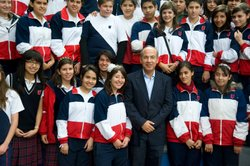 President Felipe Calderon poses with students at a school in Morelia