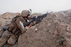 Marine fighting insurgents in Afghanistan