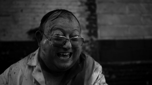 "Laurence R. Harvey stars as Martin in ""The Human Centipede 2 (Full Sequence)."""