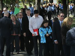 Job seekers wait in line to meet with recruiters at a job fair in Park Ridge, Ill., Sept. 15.