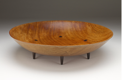 John Dirks, Salad Bowl, ca. 1954, Honduran mahogany and ebony, 16 1/4 x 4 in. This bowl and a pair of ebony utensils were published in the June 1954 issue of San Diego and Point. Collection: Dirks family. 