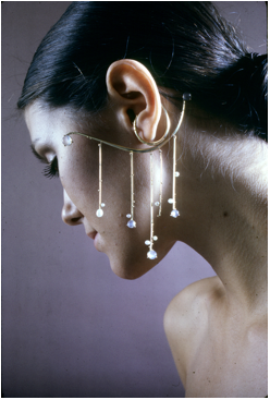 Stephanie Swigett (Gould), Ear Ornament, ca. 1971, 14K gold with granulation, moonstones, Biwa pearls (from California Design 11, 1971). Not in exhibition.