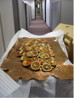 "The center section of ""Reflective Sun"" in the hallway of the San Diego Commission for Arts and Culture, just after excavation."