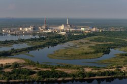 The Chernobyl power plant on the Pripyat river and with its vast cooling pond. Built in the Soviet era, the entire plant is now disused.
