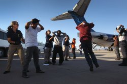 Undocumented Guatemalan immigrants are searched before boarding a deportation flight to Guatemala City, Guatemala at Phoenix-Mesa Gateway Airport on June 24, 2011 in Mesa, Arizona.