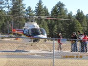 Tourists wait to board a helicopter at Grand Canyon Airport for a tour of the national park.
