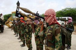 Militants belonging to Somalia's Al Qaeda-inspired Al Shabaab Islamists stand in formation on October, 21, 2010 during a show of force in Somalia's capital Mogadishu