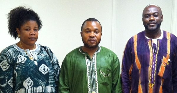 Members of the Congolese Community of Arizona gather at a recent meeting. From left to right, Saafi Lolika, Pastor Guy Lolika, and Elie Mamboleo.