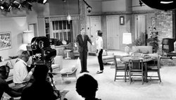 "Co-stars Dick Van Dyke and Mary Tyler Moore on the set of the iconic television series ""The Dick Van Dyke Show,"" featured in AMERICA IN PRIMETIME."
