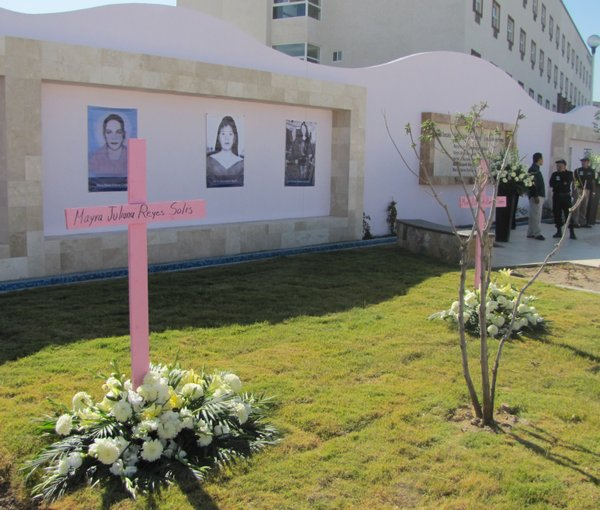 Pink crosses, photos and names are displayed at a newly dedicated memorial for women murder victims in Ciudad Juárez.