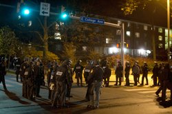 Pennsylvania State Police in riot gear line East College Avenue in the early morning hours on November 10, 2011 in State College, Pennsylvania.