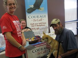 "Student Kristee Novak with Vietnam veteran Richard Jones and his dog Katie at the ""Homeless Connect"" event in Cal State San Marcos Nov 16th 2011"