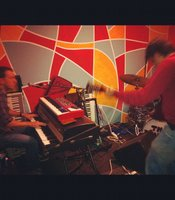 Anthony and Jessie rock out in their psychedelic rehearsal room. 