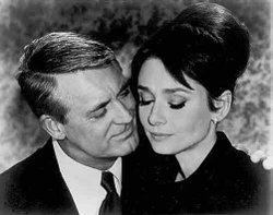 "Screenshot from ""Charade"" showing Cary Grant and Audrey Hepburn."