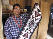 Navajo teacher Brent Chase with a traditional weaving.