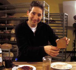 Brian Greene uses slices of bread to help explain the characteristics of gravity in parallel universes.