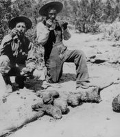 Photographer Edward H. Davis and Antonio Cuevas tasting cooked mescal, San Diego County, April 1919.