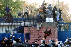 Protesters storm a security gate as they break in to the British Embassy during an anti-British demonstration in the Iranian capital on November 29, 2011 in Tehran, Iran.