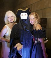 Producer Club members Kathy Bettles and Julie Hatch with costumed greeter.