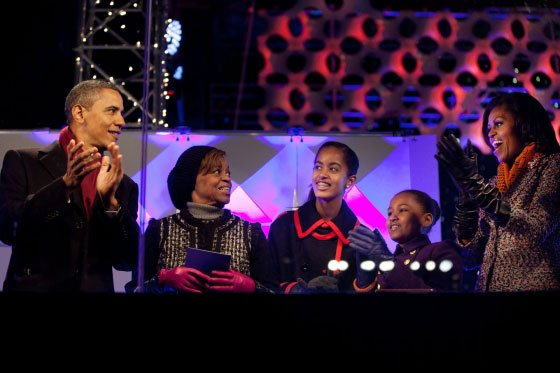 President Barack Obama, with mother-in-law Marian Robinson, daughters Malia and Sasha, and First Lady Michelle Obama, react after pushing the button to light the National Christmas Tree during a ceremony on the Ellipse in Washington, D.C., Dec. 1, 2011.