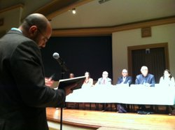 An audience member questions panelists at the University of San Diego discussion on immigration enforcement.