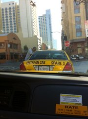 Ali speaks to younger cab drivers waiting for a fare in downtown San Diego.