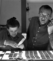 "Ray and Charles Eames selecting slides for the exhibition, ""Photography & the City, 1968."""