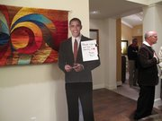 A life-size cardboard cutout of Barack Obama welcomes Democratic Party activists supporting Dr. Raul Ruiz's campaign.