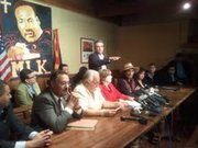 Latino politicians and community leaders at a press conference following DOJ announcement.