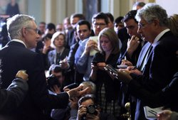 Senate Majority Leader Harry Reid speaks to members of the media during a news briefing after the weekly Democratic policy luncheon on Dec. 13 in Washington.