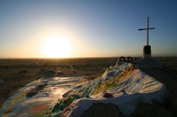 A view of the sun setting from the top of Salvation Mountain.