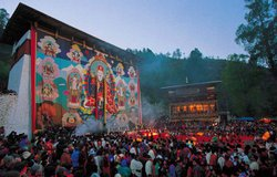 The climax of tsechu is the unfurling of an enormous thangka that envelops an entire five-storey building. It is brought out once a year and always just before dawn to avoid damage from direct sunlight, Paro, Bhutan.