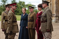 The Crawleys meet the war head on. Shown from L-R: Dan Stevens as Matthew Crawley, Julian Wadham as General Sir Herbert Strutt, Penelope Wilton as Isobel Crawley, David Robb as Dr. Clarkson, Elizabeth McGovern as Lady Cora, Hugh Bonneville as Lord Grantham